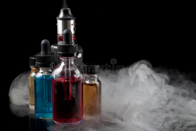 Download Electronic Cigarette And E-liquids On Black Background With Smok Stock Photo - Image of reflection, juices: 91240926