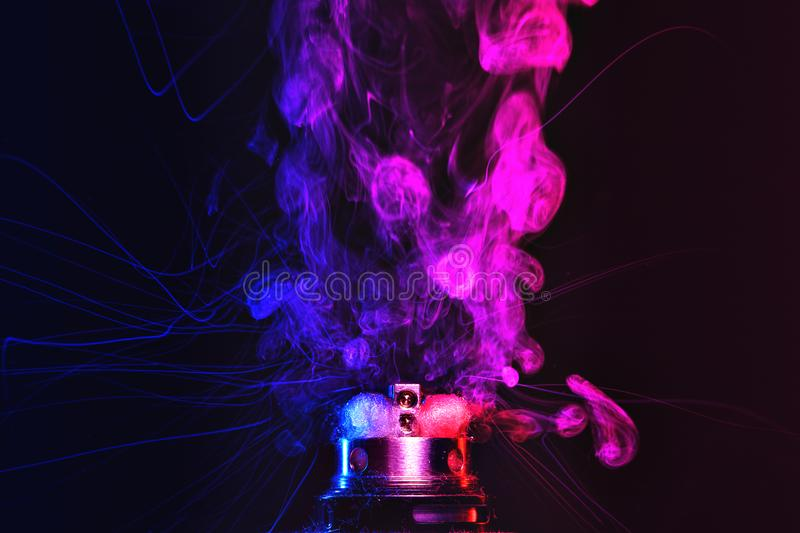 Electronic Cigarette vape explosion. cloud of vapor. Electronic Cigarette vape explosion. Dark background royalty free stock images