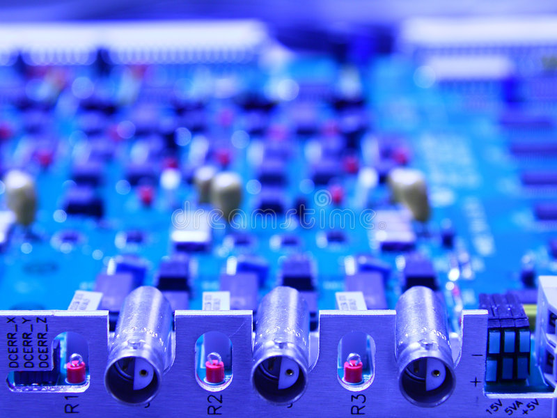 Electronic circuit board. With cable connections in blue colors royalty free stock image