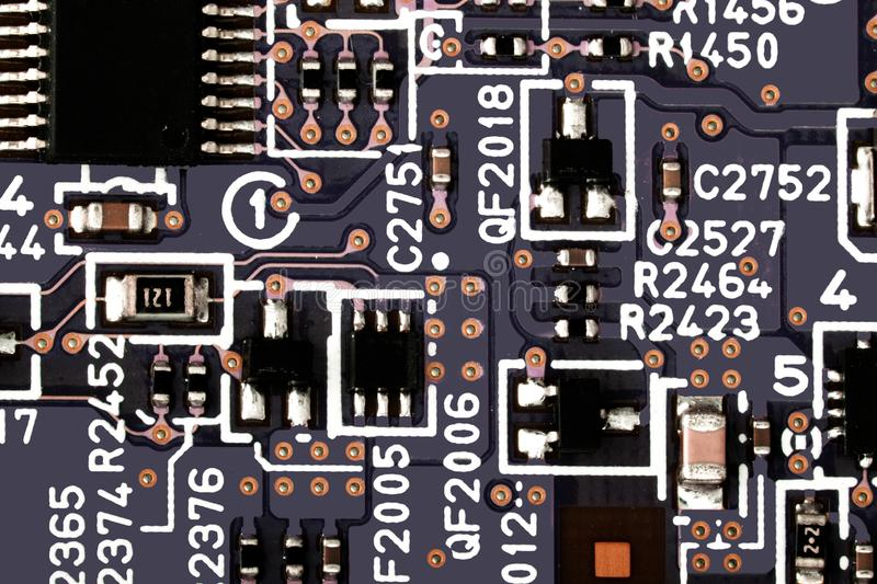 Electronic circuit board close up. Microchips and other components stock images