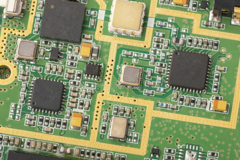 Electronic circuit board close up. Microchips and other components royalty free stock photography