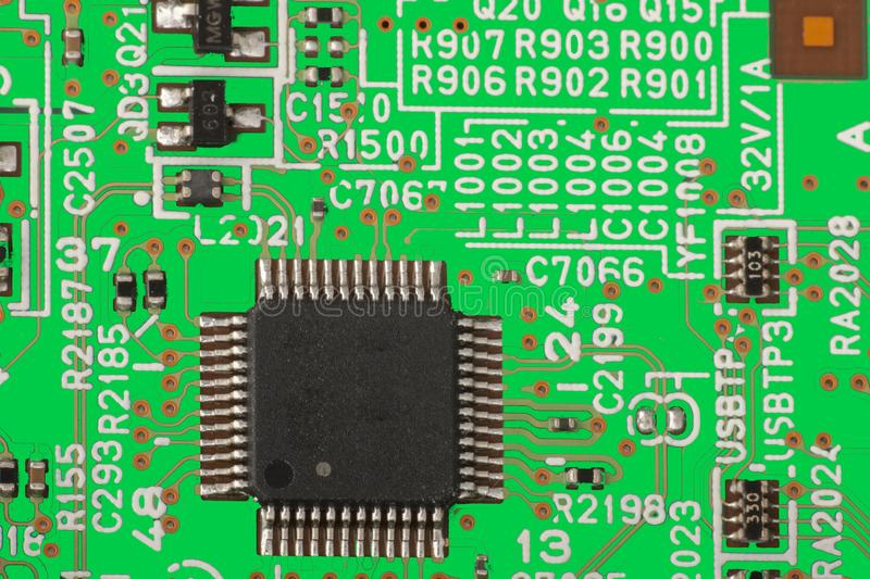 Electronic circuit board close up. Microchips and other components Toned image royalty free stock images