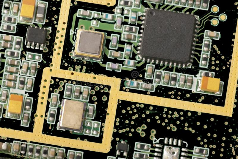 Electronic circuit board close up. Microchips and other components Toned image stock image