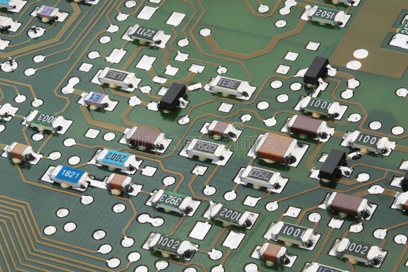 Electronic circuit board. Surface-mount components on electronic circuit board close-up stock image