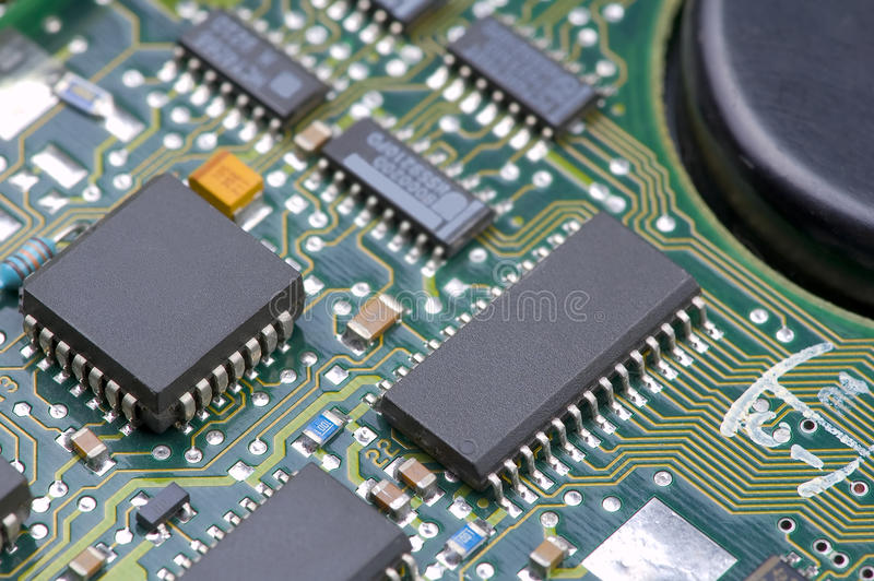 Electronic circuits. Macro image of electronic circuits and microprocessors on green electronic board stock photography