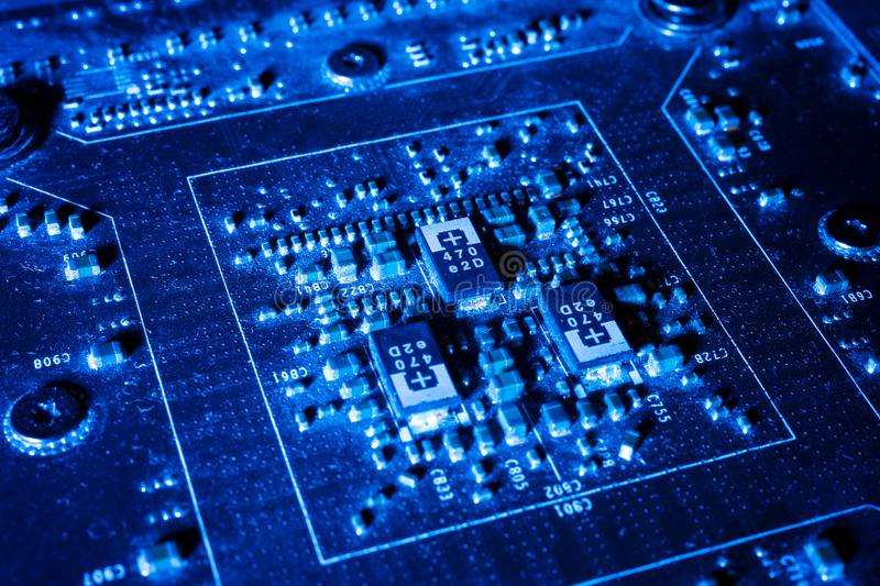 Electronic circuits in futuristic technology concept on mainboard royalty free stock images