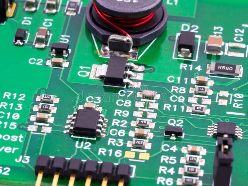 Electronic circuits. Macro image of a boost converter used in LED lighting royalty free stock images