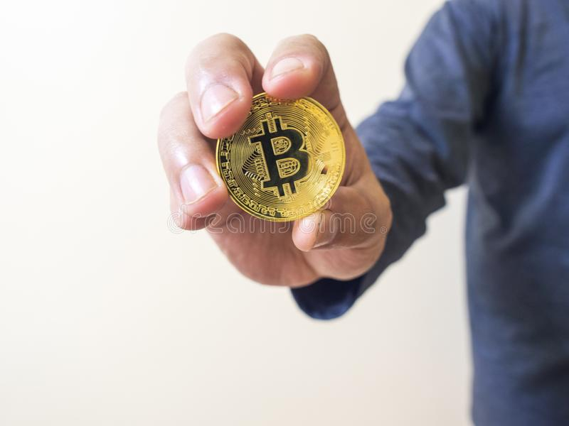 electronic coin with gold coins on top, the idea of saving money for stock photography