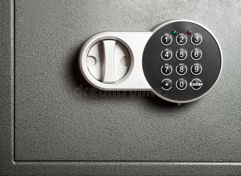 Electronic combinational lock. Close-up to steel safe door with electronic combinational lock royalty free stock image