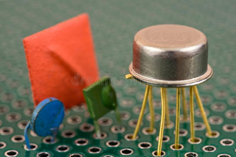 Electronic components on circuit board. Vintage electronic components on printed circuit board stock photo