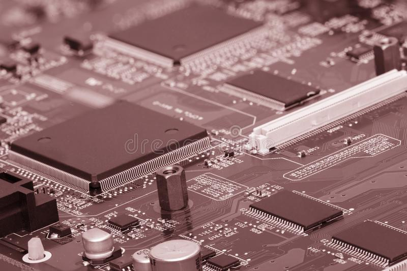Electronic components are mounted on the device board Chips diodes capacitors chokes stock photo
