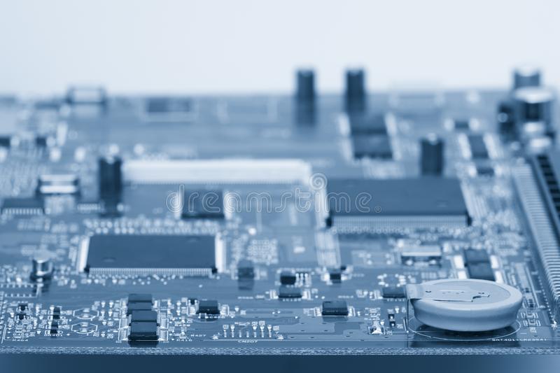 Electronic components are mounted on the device board Chips diodes capacitors chokes stock photos