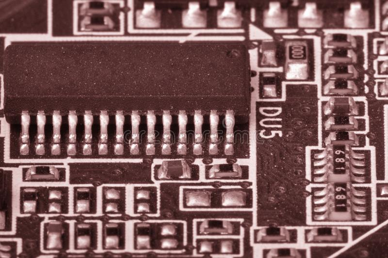 Electronic components are mounted on the device board Toned image. Electronic components are mounted on the device board Chips diodes capacitors chokes Toned stock photos