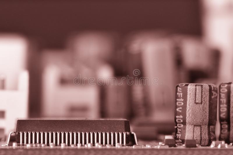 Electronic components are mounted on the device board Toned image. Electronic components are mounted on the device board Chips diodes capacitors chokes Toned royalty free stock photos