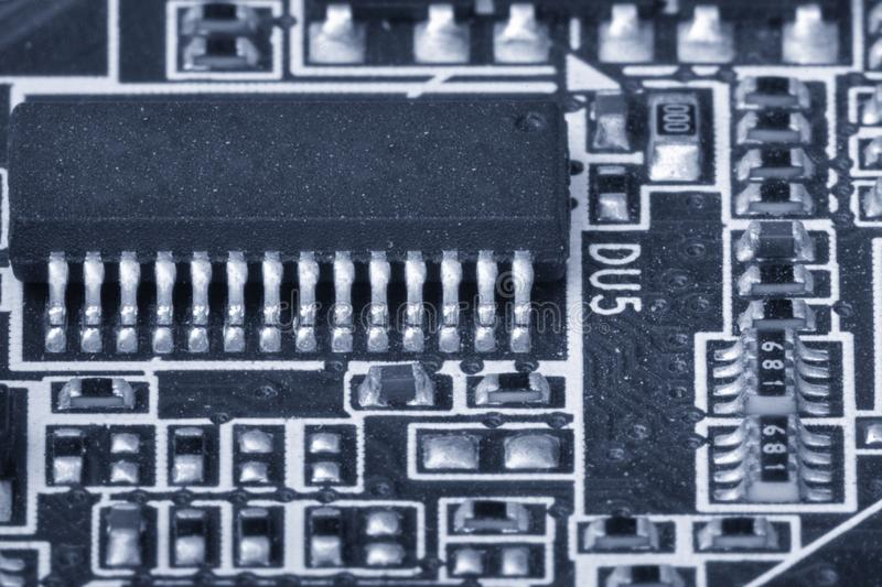 Electronic components are mounted on the device board Toned image. Electronic components are mounted on the device board Chips diodes capacitors chokes Toned stock image