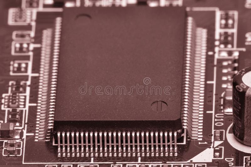 Electronic components are mounted on the device board Toned image. Electronic components are mounted on the device board Chips diodes capacitors chokes Toned royalty free stock images