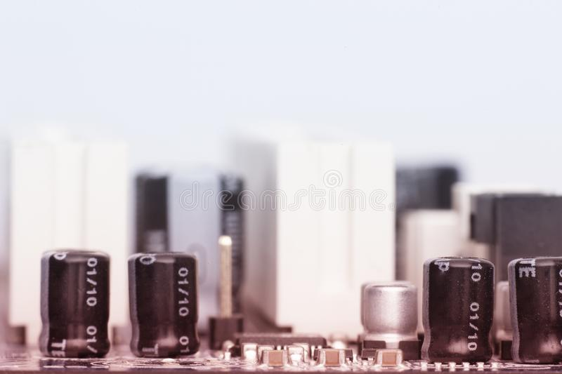 Electronic components are mounted on the device board Toned image. Electronic components are mounted on the device board Chips diodes capacitors chokes Toned royalty free stock photography