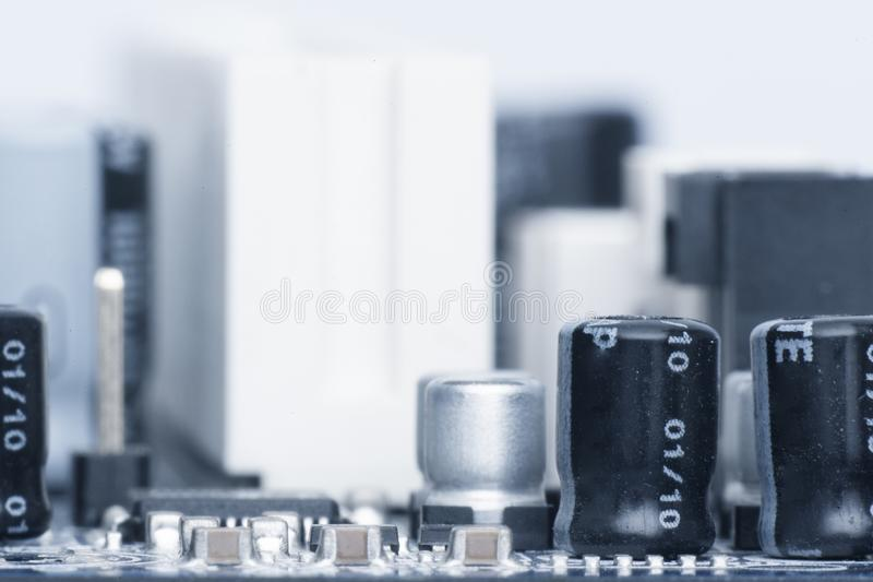 Electronic components are mounted on the device board Toned image. Electronic components are mounted on the device board Chips diodes capacitors chokes Toned stock photography