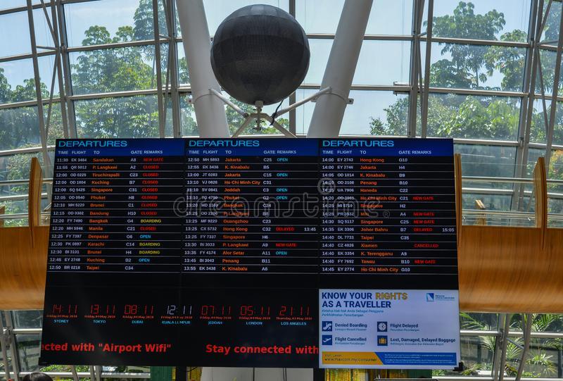 Electronic departures and arrivals board stock photo