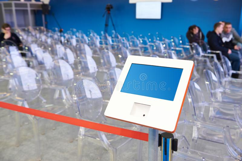 Electronic device for registering visitors. To the conference royalty free stock photos