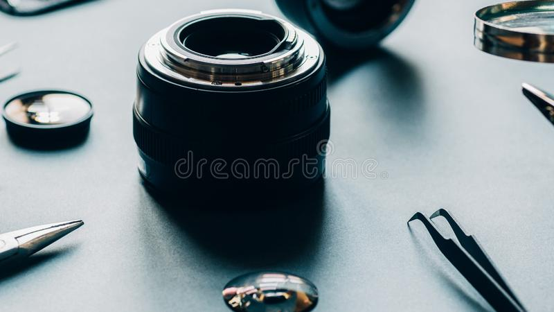 Electronic device service photo camera lens repair. Electronic device service. Closeup of photo camera optical dslr lens and repair tool set stock image
