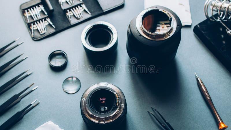 Electronic device service photo camera lens repair. Electronic device service. Photo camera optical dslr lens and repair tool set stock photos