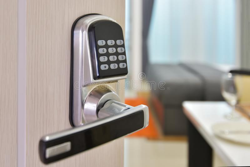 Electronic door access control system machine with number password door..Half opened door handle closeup, entrance to a living stock image