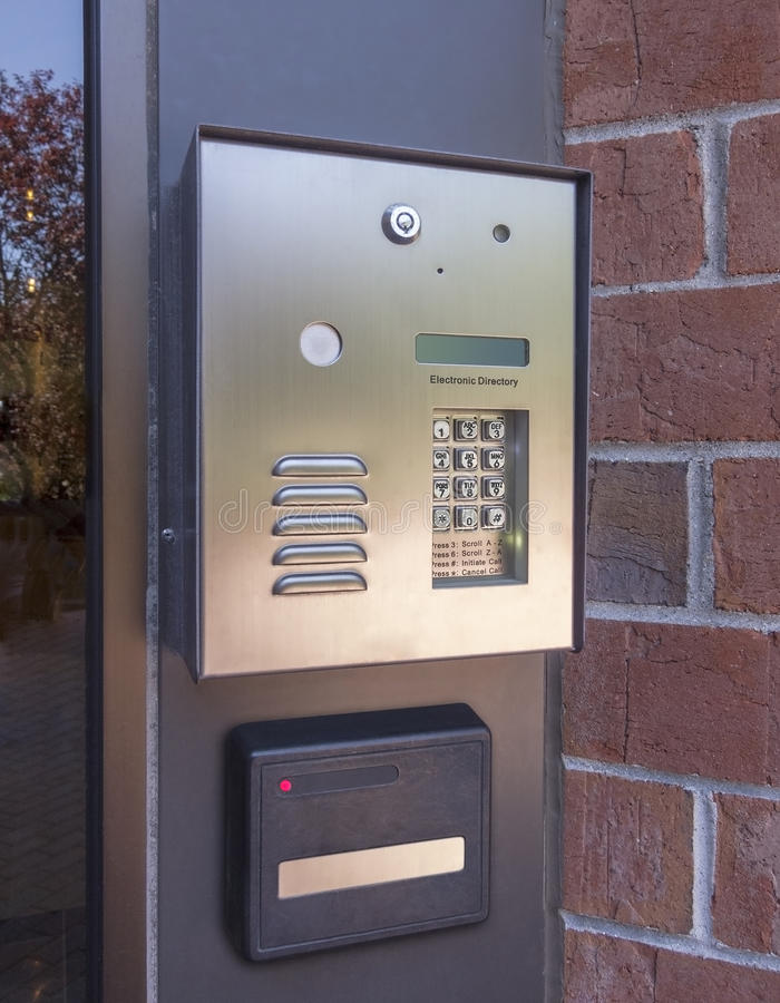Electronic door directory and security pad. Near the front door entrance of a commercial building royalty free stock photos