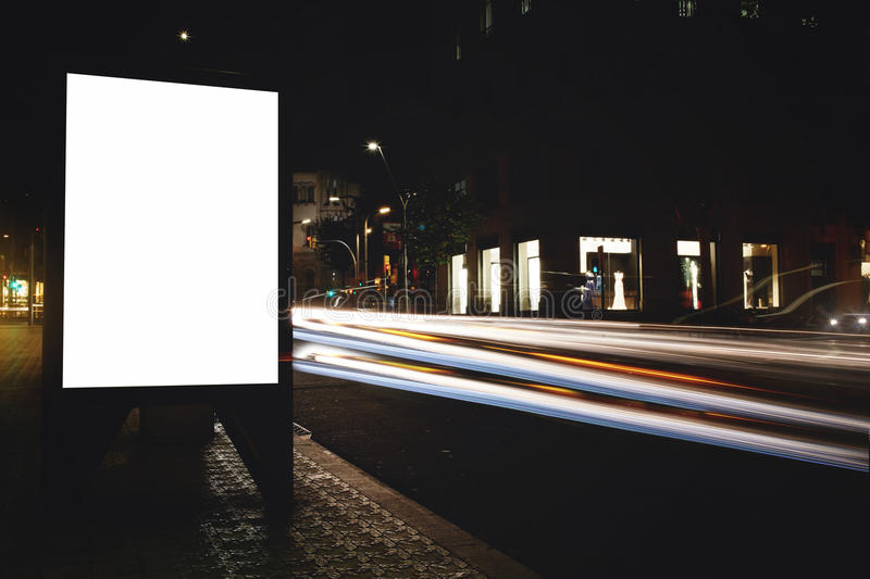 Electronic empty billboard with copy space for your text message or content, public information board with light streaks on backgr. Advertising mock up in urban royalty free stock image
