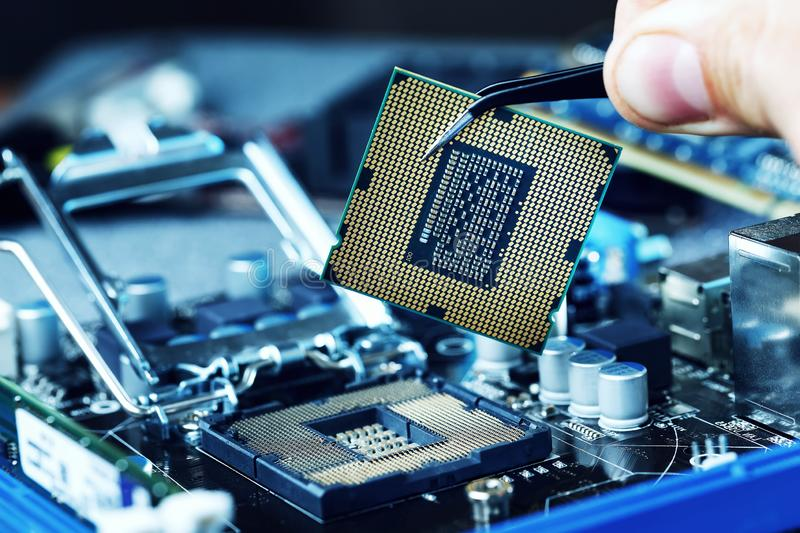 Electronic engineer of computer technology. Maintenance computer cpu hardware upgrade of motherboard component. Pc repair,. Technician and industry support royalty free stock image