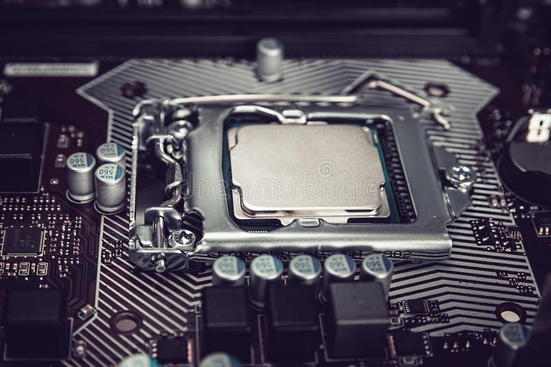 Electronic engineer of computer technology. Maintenance computer cpu hardware upgrade of motherboard component. Pc stock images