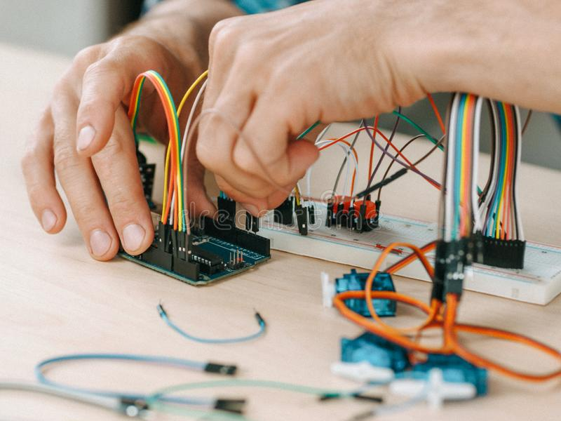 Electronic engineering workplace technician lab. Electronic engineering workplace. Technician connecting components at lab royalty free stock photo