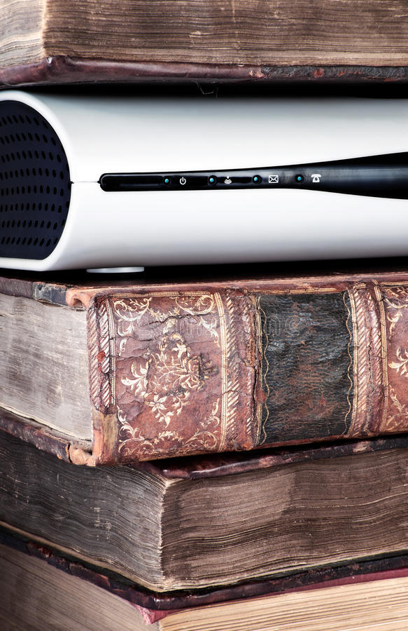 Free Electronic Equipment In A Pile Of Old Books Royalty Free Stock Photography - 12775457