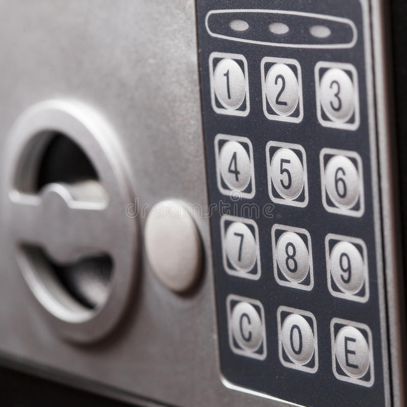 Electronic home safe keypad, Small home or hotel wall safe with keypad. Closeup royalty free stock images