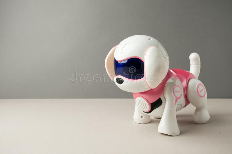 Electronic interactive toy dog puppy on a gray background, high technology concept, pet of the future, electronic home, copy space stock photo