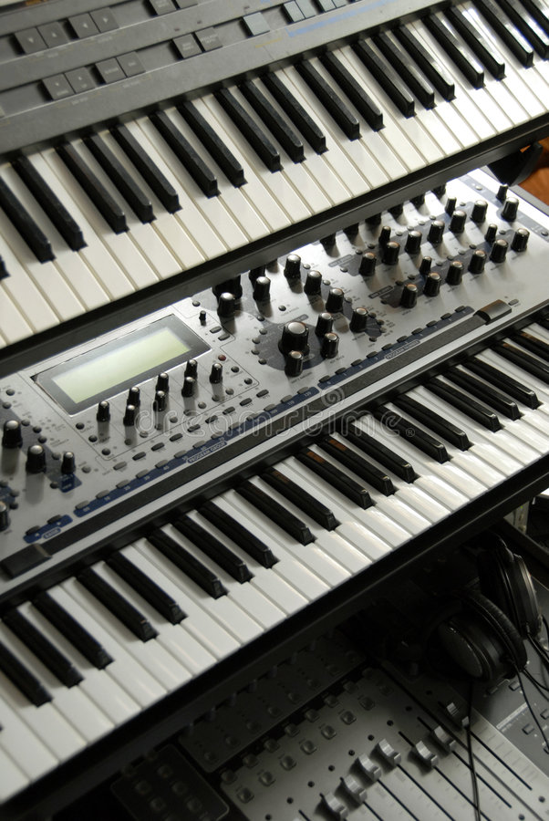 Electronic Keyboards on a rack stock photo