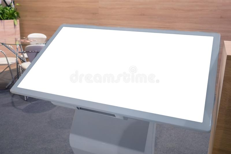 Electronic kiosk with horizontal blank interactive white display. White screen, mock up, future, copyspace, template, , technology concept. Electronic kioskwith stock photography