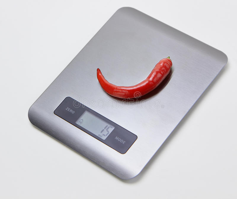 Electronic kitchen scales with a pepper stock images