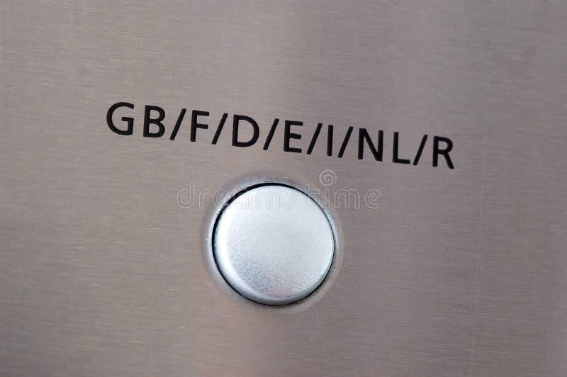 Electronic language button stock image