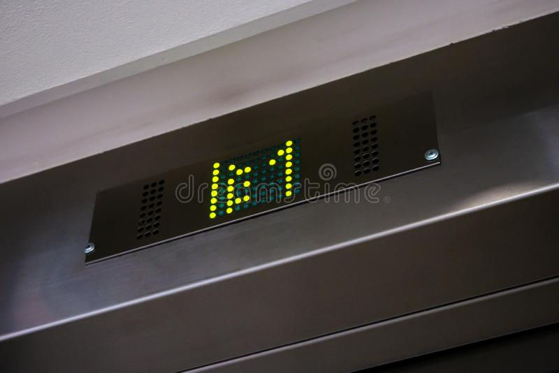 Electronic LCD elevator display with floor number one stock photos
