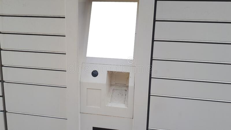 Electronic Locker,automated parcel terminal on the street with empty screen for mockup, stock image