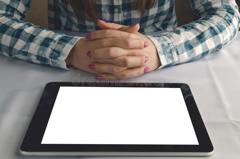 Electronic menu template. Tablet computer with blank screen. Student girl reading e-book. stock photo