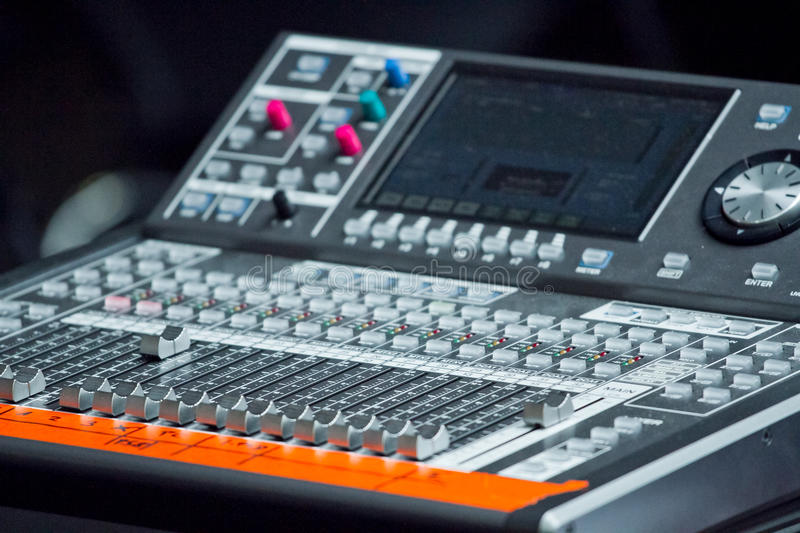 Electronic mixing desk. With an orange notice-tape stock images