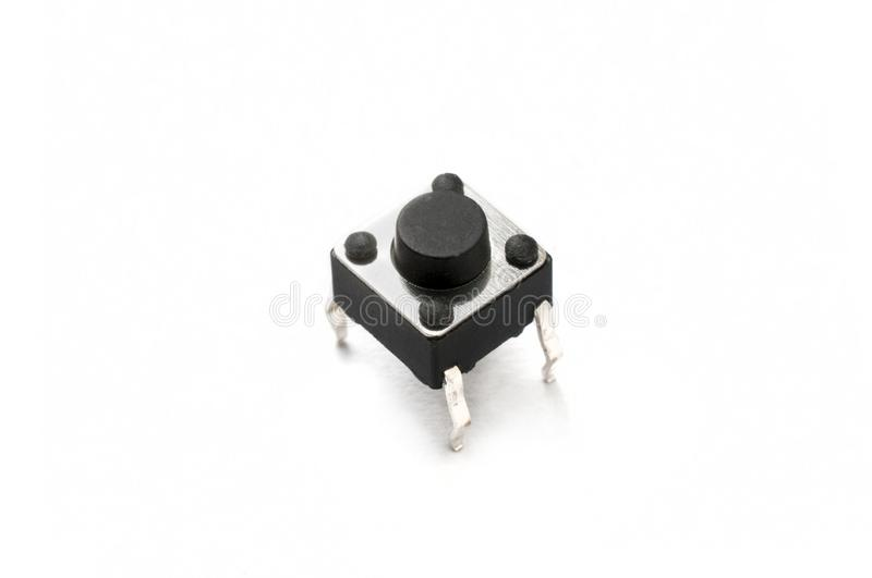 Electronic momentary push button switch  on white background royalty free stock photo