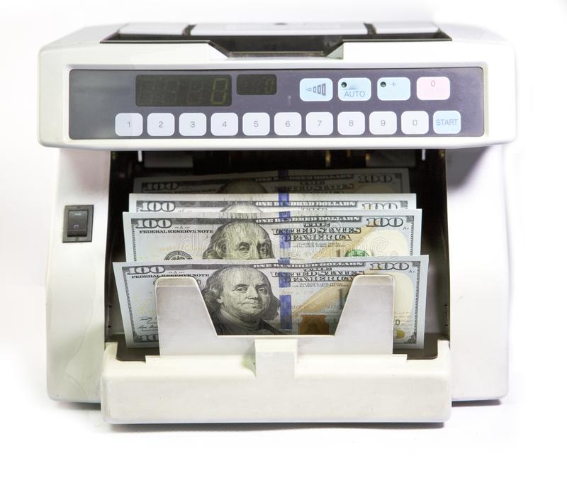 Electronic money counter machine is counting is counting the American hundred-dollar US dollars banknotes.  stock photos