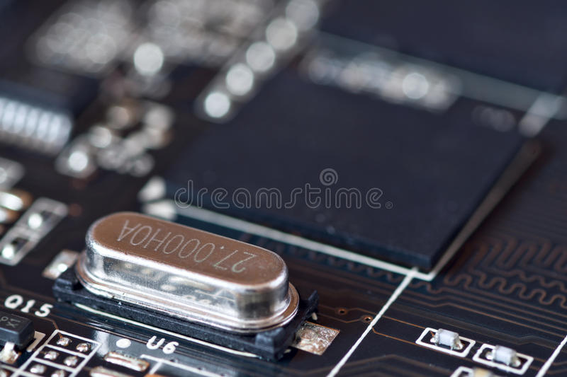 Electronic oscillator circuit on motherboard. Electronic oscillator circuit mounted on motherboard stock image