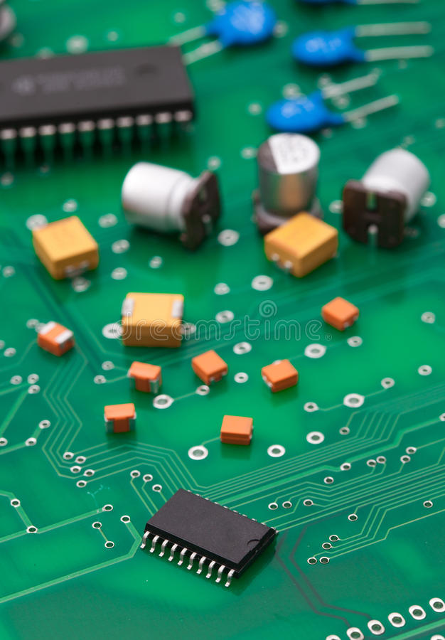Electronic part on green PCB.  stock photos