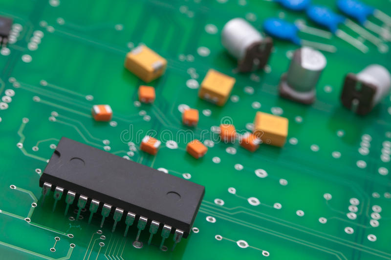 Electronic part on green PCB.  royalty free stock image