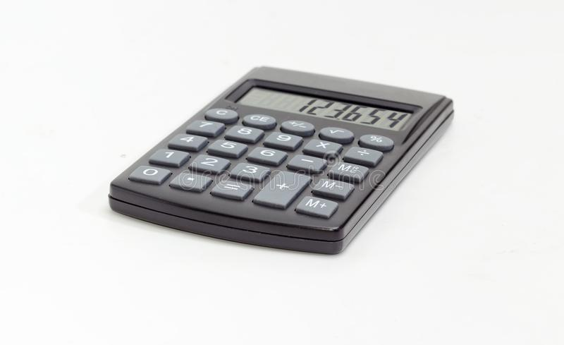 Electronic pocket calculator on a white background at selective. Modern electronic pocket calculator with a liquid-crystal display at selective focuson on a royalty free stock photo