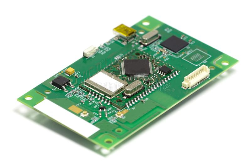 Electronic printed circuit board with chips and other components, front side, angled view, isolated on white stock photography